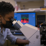 Ikelle, conducting research in a BME lab.