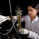 Environmental Engineering graduate student Archana Venkataramanan works with a electrocoagulation unit designed for drinking water purification research. Photo by Stephen Pinchback.