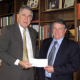 John Duty, executive vice president of Bechtel, Inc., presents Dean Flumerfelt with a check for scholarship support on behalf of the Bechtel Group Foundation.