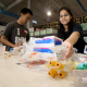 Sophomore biomedical engineering majors Kevin Shih and Sheetal Shah sort medical supplies for Project Cure, a nonprofit organization dedicated to supplying needy hospitals and clinics overseas with the tools to fight disease. Photo by Thomas Shea.