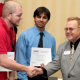 Engineering seniors John Hemmick and Osaid Shamsi receive a first place award in the Region 5 IEEE Technical, Professional and Student Conference regional circuit design competition. Photo by Tom Shea.