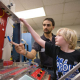 Logan Craft, 10, is given a demonstration on smart materials by Ph.D. student Claudio Olmi during one stop on a tour of the college June 30. Photo by Thomas Shea.