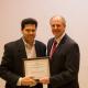 Grigoriadis Accepts Award From Dean Tedesco