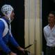 Jose Luis Contreras-Vidal (right) demonstrates his non-invasive brain-machine interface exoskeleton in 2013.