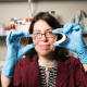 Haleh Ardebili, Bill D. Cook Assistant Professor in mechanical engineering, with her bendable battery roughly the size of a business card