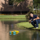 Becker's student Haoran Zhao launches drone at pond by the Cullen College