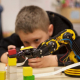 Oliver, a fourth grader at UH Charter School, is keen on learning about robots
