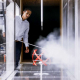 Daniel Araya, assistant professor of mechanical engineering, demonstrates how his wind tunnel can generate electricity. Photo courtesy of Michael Ciaglo, Houston Chronicle Staff