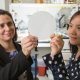 Debora Rodrigues (left) and Yandi Hu hold mesh polyamide filter they will modify to advance water purification