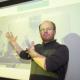 Konrad Krakowiak welcomes MIT students into his classroom via the big screen