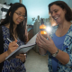 Stacey Louie, assistant professor of civil and environmental engineering, left, and Debora Rodrigues, associate professor of civil and environmental engineering, examining nanoparticles, to find new materials that will break down pollutants and work in sunlight