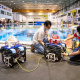 Associate Professor Aaron Becker and robotic swarm lab members Steban Soto and Javier Garcia conduct tests of a submersible ROV pairing at the Neutral Buoyancy Lab in August.